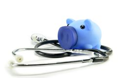 Stethoscope and piggy bank. Showing medical or financial concept Royalty Free Stock Image