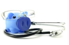 Stethoscope and piggy bank. Showing medical or financial concept Stock Photos