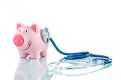 Stethoscope and piggy bank Royalty Free Stock Photo