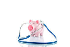 Stethoscope and piggy bank Stock Image