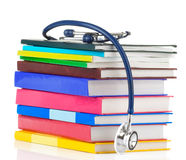 Stethoscope and pile of books Royalty Free Stock Photos
