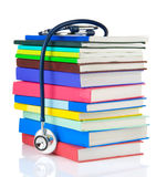 Stethoscope and pile of books on white Royalty Free Stock Photos