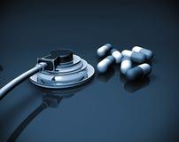 Stethoscope and pills Stock Photos