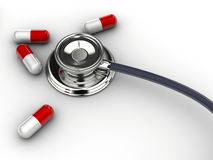 Stethoscope and pills Stock Image
