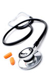 Stethoscope And Pills Stock Images