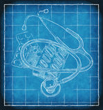 Stethoscope and pills on blueprint Royalty Free Stock Photo