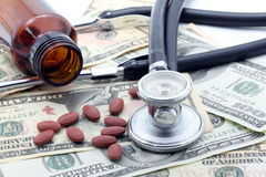 Stethoscope and Pills on dollars Stock Photo