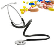 Stethoscope and pills isolated Stock Image