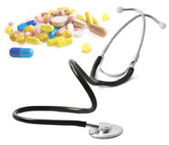 Stethoscope and pills isolated Royalty Free Stock Images