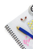 Stethoscope with pills and notebook Stock Photo