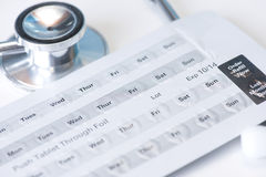 Stethoscope and Pills. Stethoscope and daily schedule blister pack with medication Stock Photos