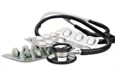 stethoscope and pills on white Royalty Free Stock Image