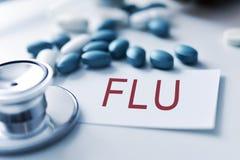 Stethoscope, pills and word flu Stock Image