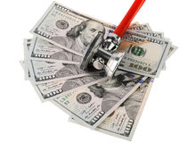 Stethoscope placing on US dollars banknotes isolated on a white royalty free stock photography