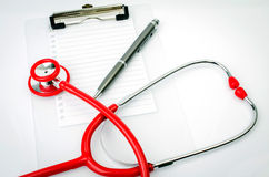 Stethoscope with plastic clipboard , blank paper and pen Royalty Free Stock Photos