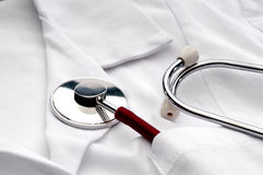 A stethoscope in a pocket of a white lab coat. Close up of a stethoscope in a pocket of a doctor's white lab coat Royalty Free Stock Photo