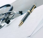 Stethoscope,x-ray and pen on the table. Royalty Free Stock Photos