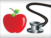 Stethoscope and red apple Royalty Free Stock Image