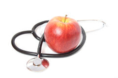 Stethoscope and red apple Royalty Free Stock Images