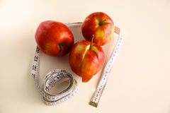 Stethoscope with red apples on a white background Royalty Free Stock Image