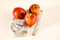 Stethoscope with red apples on a white background Stock Images