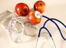 Stethoscope with red apples on a white background Stock Photo