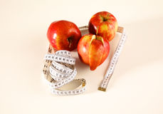 Stethoscope with red apples on a white background Royalty Free Stock Photos