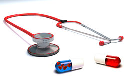 Stethoscope with red and blue pills isolated Stock Photos