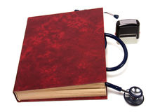 Stethoscope on red book Stock Photos