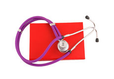 Stethoscope on the red book Stock Photos