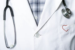 Stethoscope and a red clip Royalty Free Stock Photography