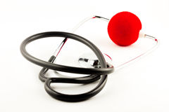 Stethoscope with red clown nose Royalty Free Stock Photography