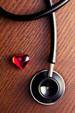Stethoscope and red heart Stock Images