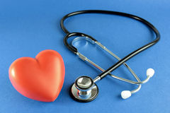 Stethoscope and a red heart Royalty Free Stock Photos