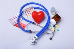 Stethoscope and red heart, Colored Pills, Tablets, Capsules Blisters for Pharmacy and Medicine. Stethoscope and red heart, Colored Pills, Tablets, Capsules stock image