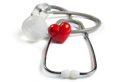 Stethoscope, red heart and global earth Royalty Free Stock Images