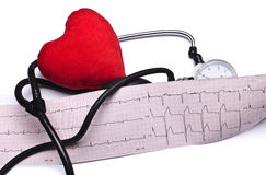 Stethoscope, red heart and hemopiezometer EKG Royalty Free Stock Photo