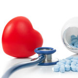 Stethoscope with red heart and pills - studio shoot on white - 1 to 1 ratio Royalty Free Stock Images