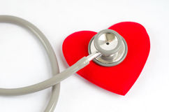 Stethoscope with red heart on white background - Health care con Royalty Free Stock Images