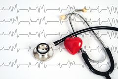 Stethoscope with red heart on white table .Medical accessories. With copy space stock photography