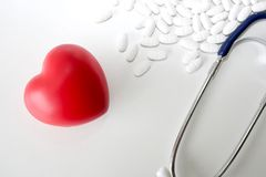 Stethoscope and red heart on a white wooden background. Medicine and healthy. Tokyo Japan stock photos