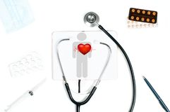 Stethoscope and red heart. Doctor table with medical items. Stethoscope and red heart. Workplace of doctor with medical items and pills stock photos