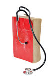Stethoscope on red old book Royalty Free Stock Image