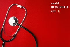 Stethoscope on a red table, concept medicine. World hemophilia day Stethoscope on a red table, concept medicine Stock Photos