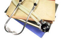 Stethoscope on Reference Books. A medical stethoscope resting on a stack of reference books Stock Images