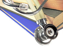 Stethoscope on Reference Books. A medical stethoscope resting on a stack of reference books Stock Image