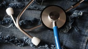 Stethoscope with reflection, jeans style Royalty Free Stock Photography
