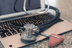 Stethoscope reflex hammer on keyboard countertop ready for use and data entry royalty free stock photo