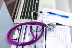 Stethoscope resting on a computer keyboard -. Concept for online medicine or IT support Stock Photos