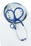 Stethoscope and scale Royalty Free Stock Photo